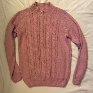 Pink cable knit turtleneck with pearl accents